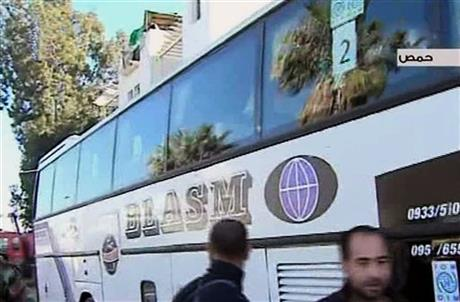 SYRIA BEGINS EVACUATING CIVILIANS TRAPPED IN HOMS