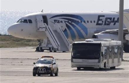 Egypt plane drama ends: hijacker arrested, passengers freed