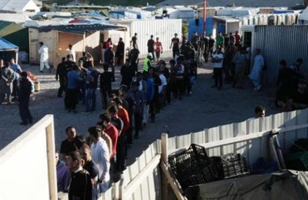 Tensions mount as record numbers crowd French migrant camp